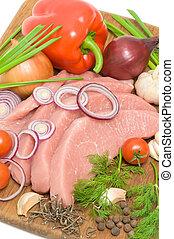 schnitzel of pork and vegetables close up - schnitzel of...