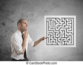 Businessman with maze - Businessman looking for a solution...