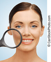 woman with magnifying glass over acne - bright picture of...