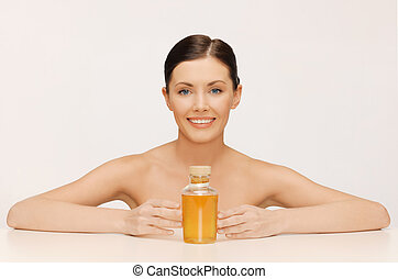 woman with oil bottle - picture of beautiful woman with oil...