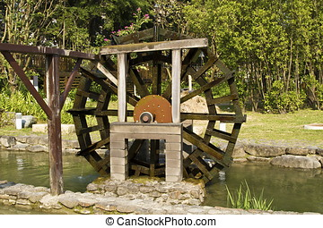 wooden waterwheel in green park