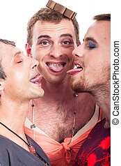 Funny transvestites sticking out tongue - Close up of funny...