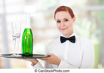 young waitress serving champagne