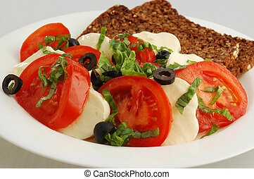 Tomatoes with mozzarela - A plate with tomatoes, mozzarela...