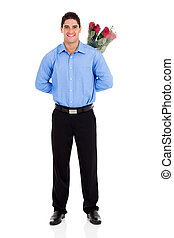 romantic young man hiding roses - romantic young man hiding...