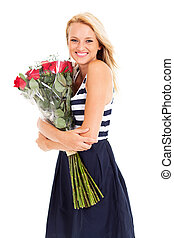 happy young woman hugging roses