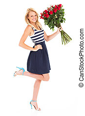 happy young woman with bunch of roses