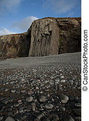 Shale buttress - A pebble shore leads to a shale buttress on...