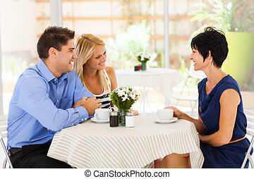 meeting future mother in law in cafe - young woman with...