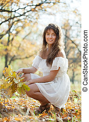 Outdoor portrait of long-haired girl