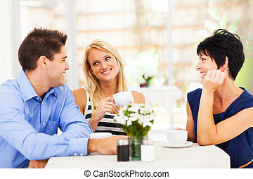 man meeting mother in law with his wife - happy young man...