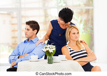 caring mother reconciling couple - caring mother reconciling...