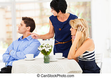 mother pointing finger at son-in-law as she took daughters...