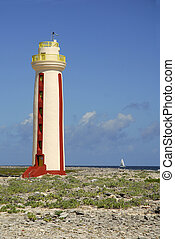 Bonaire Lighthouse - A sailboat passes the the Willemstoren...