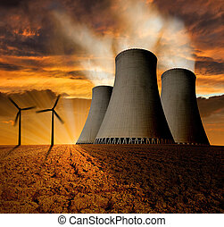 energy concept - Sunset over the nuclear power plant with...