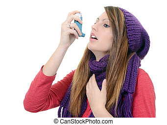 Woman with asthma using an asthma inhaler - Woman with...