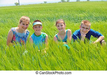 Cousins in wheat field