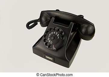 Vintage phone on white background - Old black Bakelite...