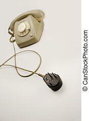 Unplugged analog gray telephone black connecting plug -...