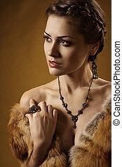 Woman in luxury fur coat. Vintage style
