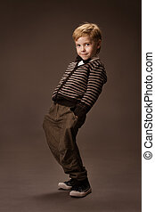 Boy vintage style - Happy Boy dancing over brown background...