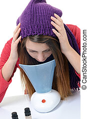 A young woman with colds and flu inhaled essential oils
