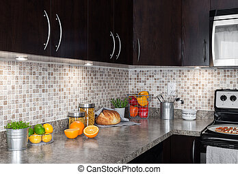 Contemporary kitchen with food ingredients on countertop -...
