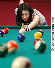 Shooting pool - Photo of a beautiful brunette about to shoot...