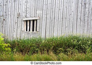 Wood barn window - Rustic wooden building window in rural...