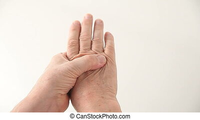 finger joint pain - a man with pain in and around his finger...