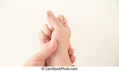 hand numbness - a man tries to work out the numbness in his...