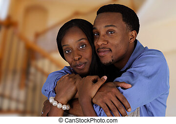 Married Couple - Man and woman posing together inside their...