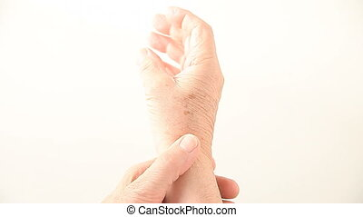 checking wrist movement - a man flexes and moves his painful...
