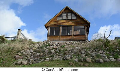 summer house hill sky - rural wooden summer house on stone...