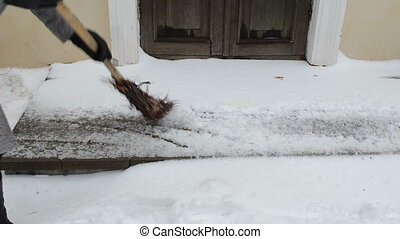 woman sweeper snow winter