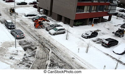 clean snow parking lot - tractors excavators clean snow...