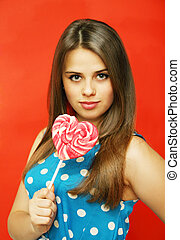 candy heart-shaped - Beautiful girl with a big candy...