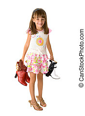 The girl and footwear - The little girl trying on footwear a...