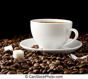 cup of coffee on beans - cup of coffee and sugar on beans