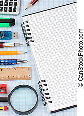school accessories and checked notebook on graph grid paper