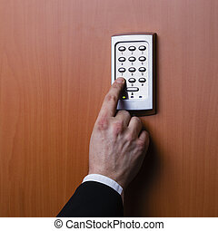 electronic security system being activated - electronic key...