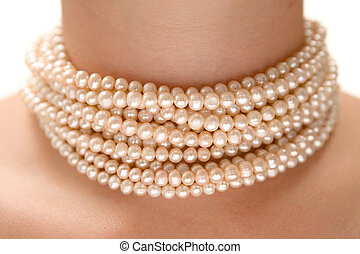 Wearing a Peal Necklace - Precious pearls on a womans neck....