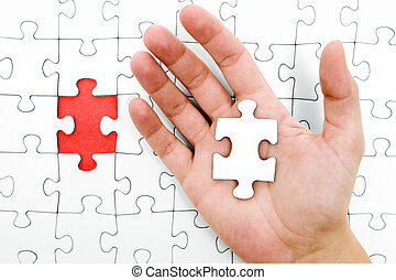 Holding a Jigsaw Piece - Open hand with the missing puzzle...