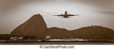 Plane over Rio de Janeiro - A plane taking into air over Rio...
