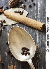 Spices and Old Spoon on Timber - Spices with old spoon over...