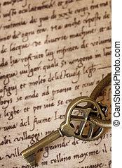 Antique Brass Key on Old Script
