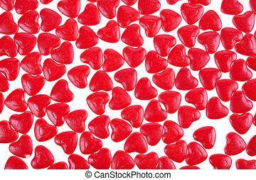 red hearts background - red hearts shaped candy as...