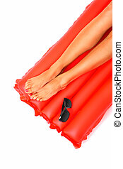Time to relax - A picture of female legs lying on a red...