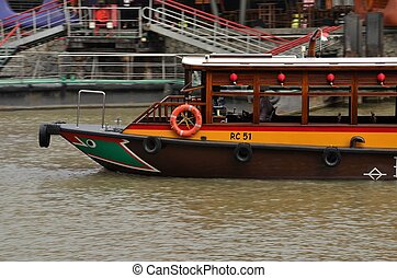 Tourist ferry boat: Singapore - Tourist bum boat moving at...