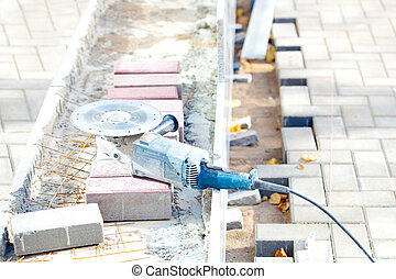 Angle grinder at construction site - Electric angle grinder...